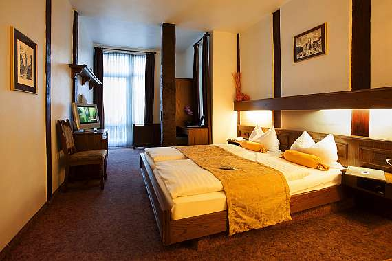 A spacious double room at the historic Centro Hotel Ritter St. Georg in Braunschweig