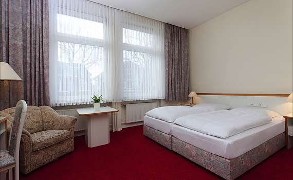 A double room with panorama windows at Centro Hotel Kaiserhof in Lübeck